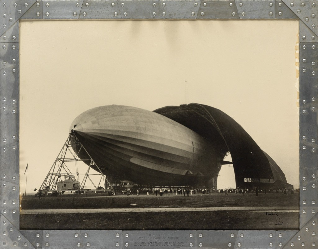 Lot 105: Margaret Bourke-White, U.S.S. Airship Akron, World's Largest Airship, silver print in duralumin frame, 1931. At auction October 25, 2016. Estimate $2,500 to $3,500.