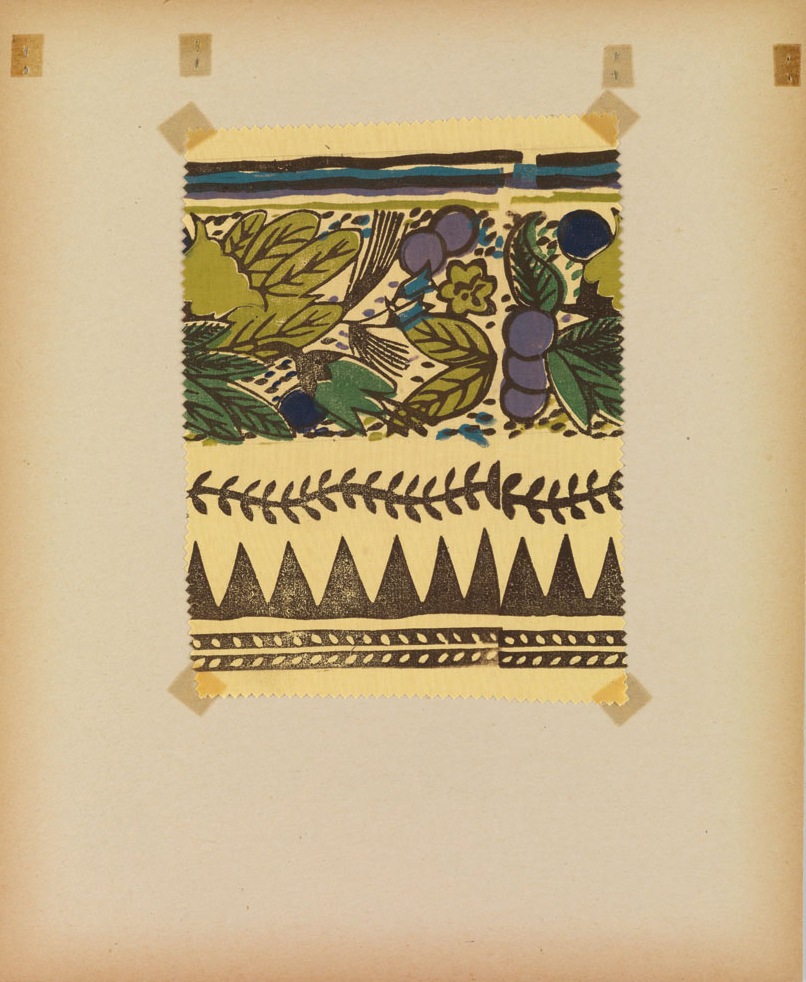 Interior of Applied Design: Block Printed Textiles, showing hand-taped fabric samples.