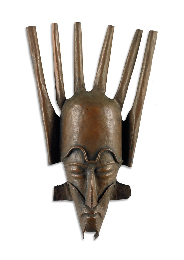 Lot 81: Beulah Woodard, Mask, sheet metal with copper patina, circa 1935. Estimate $7,000 to $10,000.