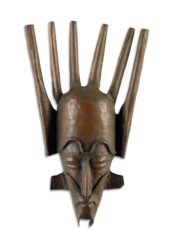 Lot 81: Beulah Woodard, Mask, sheet metal with copper patina, circa 1935. Estimate $7,000 to $10,000.