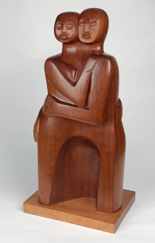 Red mahogany sculpture mounted on a wood base by Elizabeth & David Mora Catlett.