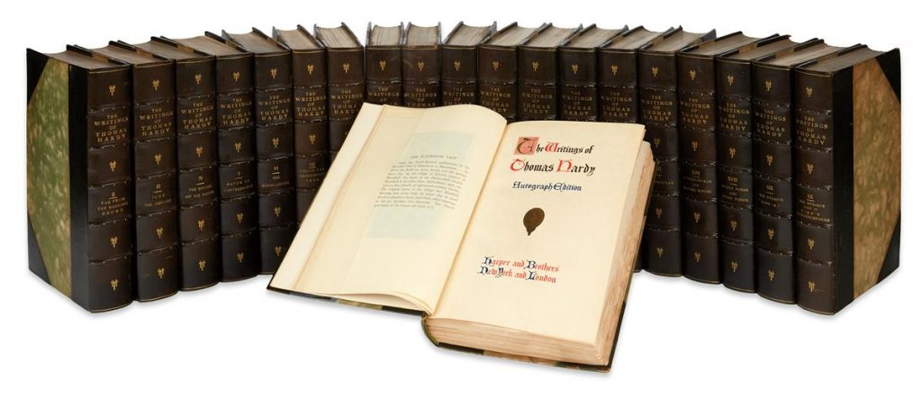 Lot 133, all 20 volumes with an open book turned to the cover page, Thomas Hardy's The Writings of Thomas Hardy in Prose and Verse.