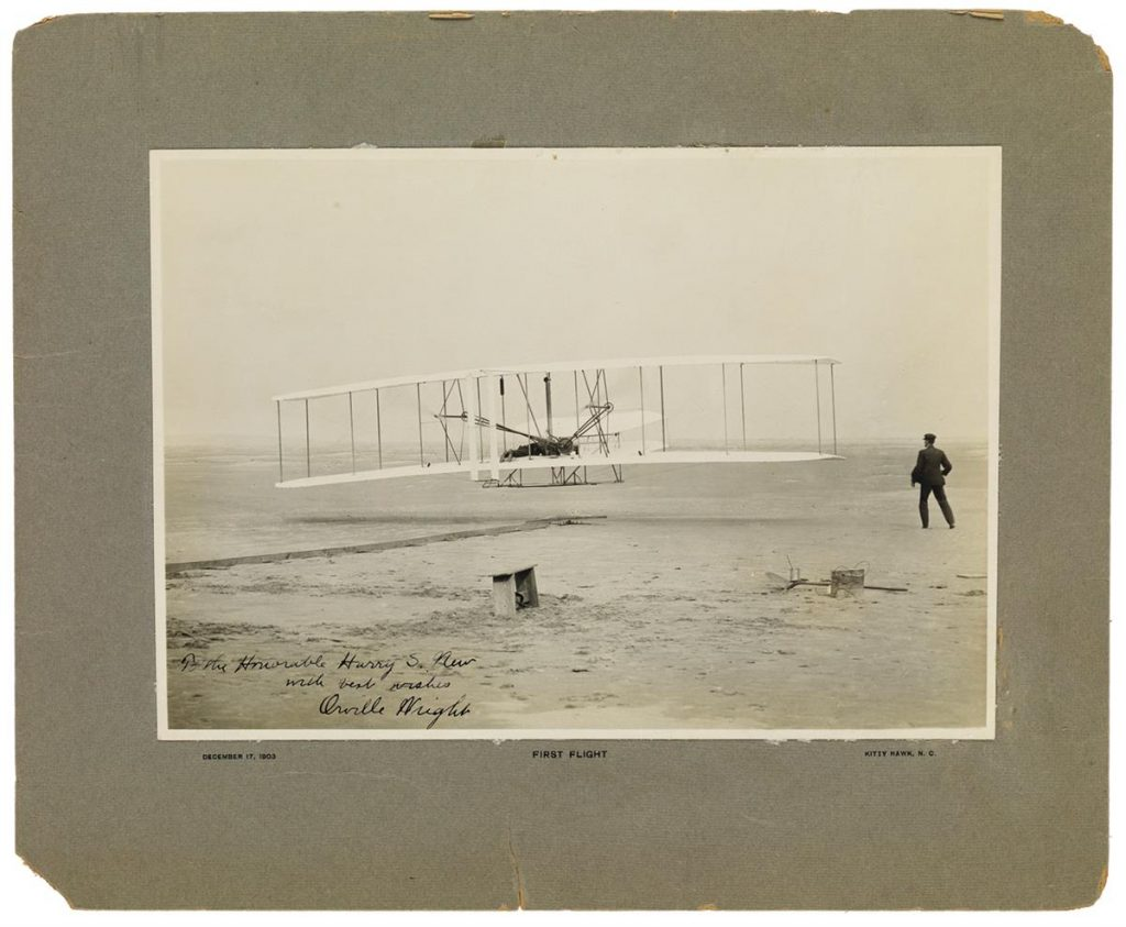 Lot 96, a photograph signed by Orville Wright showing the first flight of the Wright Flyer.