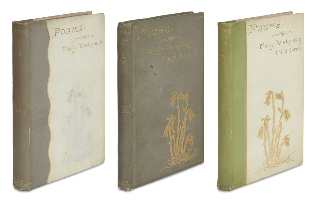 Emily Dickinson's first three books of poetry showing the covers of each one white and gray, one gray, and one green and white.