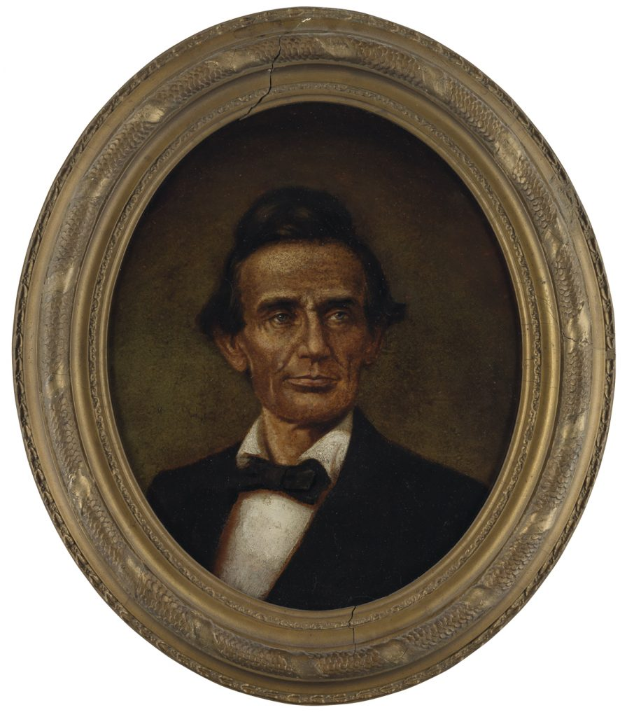Framed oval portrait of a hatless Abraham Lincoln by John C. Wolfe