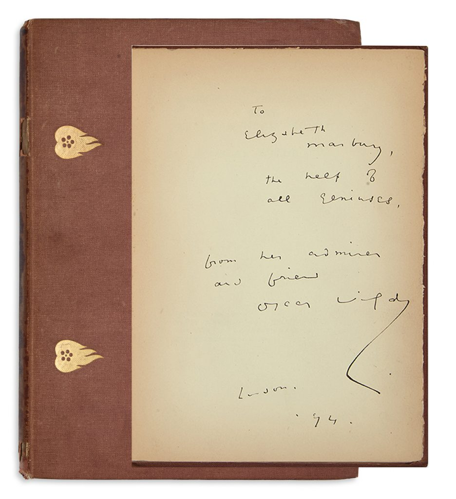 Oscar Wilde's Lady Windermere's Fan shown with the front cover and inscription and signature.