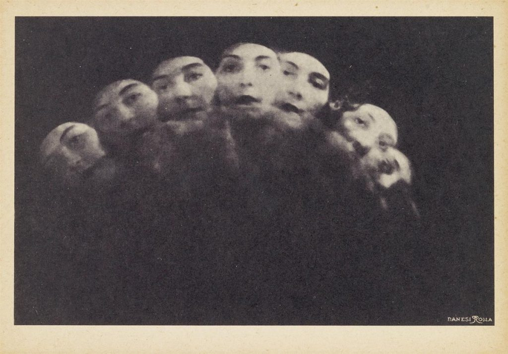 Anton Giulio Bragaglia's Scrutando (Peering Woman), on carte-postale paper. Moving photograph of a woman's head.