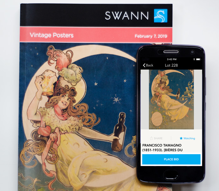 Swann catalogue and a mobile phone with the live bidding App