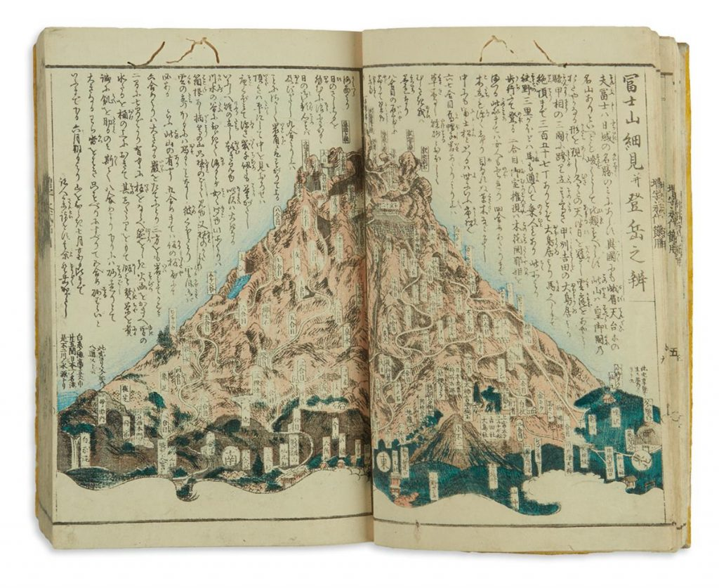 A two illustration of a volcano with Japanese writing overlayed from a massive Edo-period Japanese atlas.