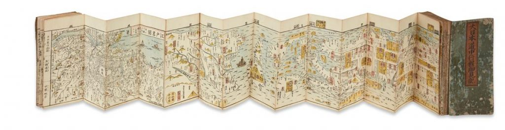 A panoramic map of the roadways, waterway, cities, towns and topography of the entire island chain of Japan.