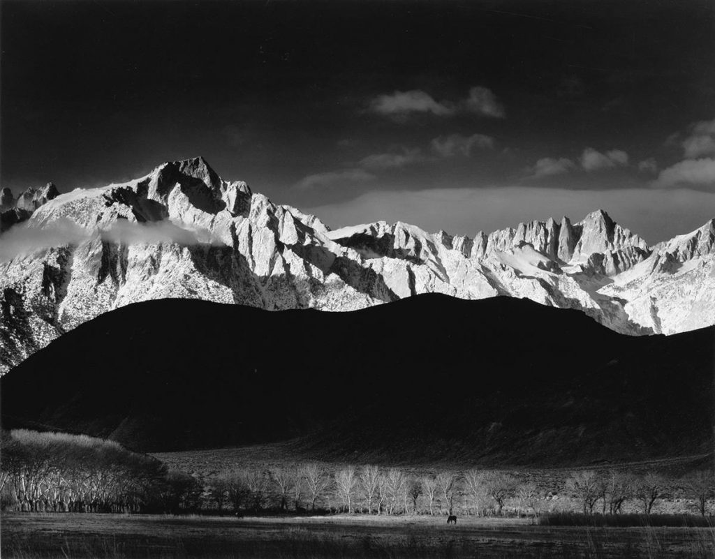 Black and white image of a mountain range by Ansel Adams.