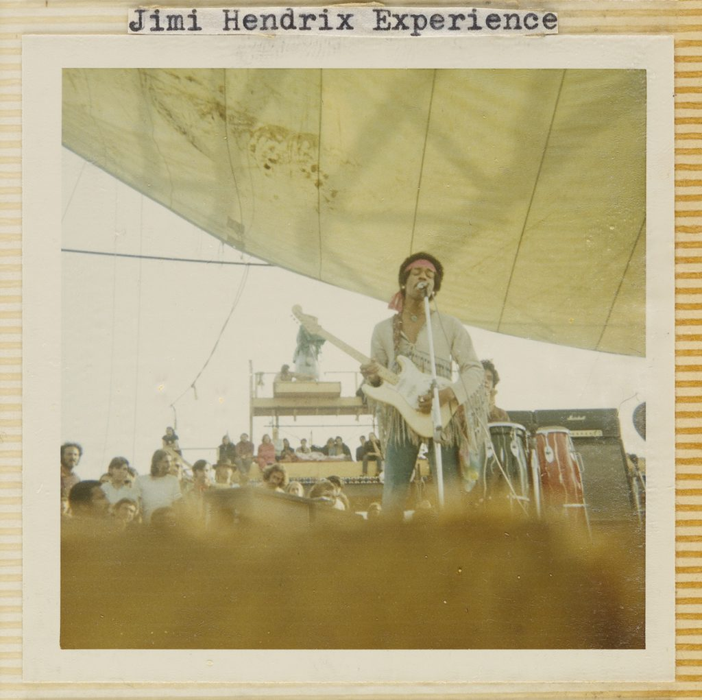 "Photograph of Jimi Hendrix at Woodstock captioned ""Jimi Hendrix Experience"""