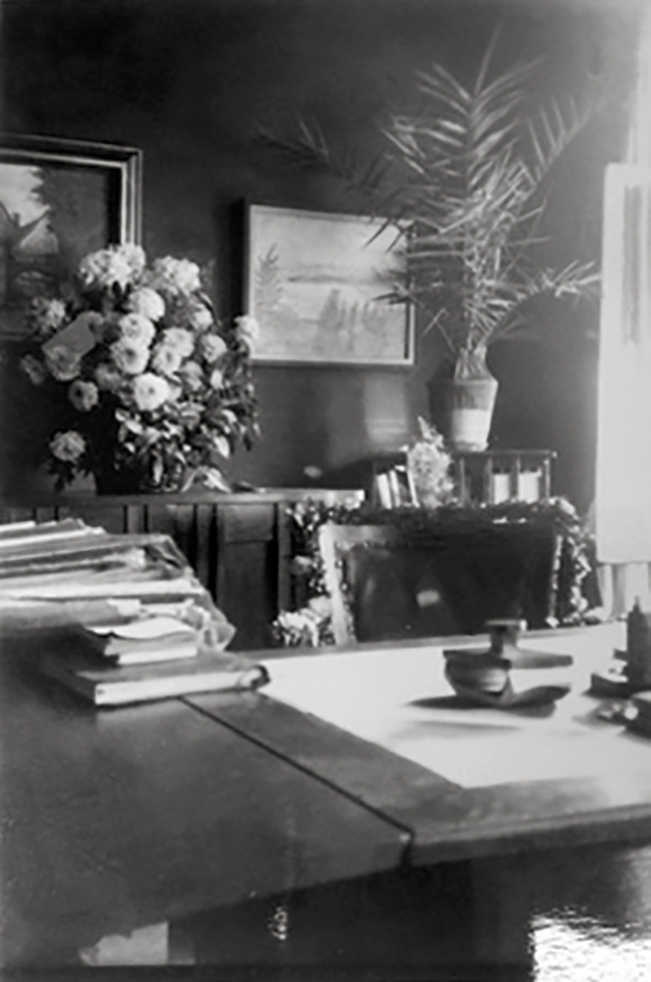 Interior view of Ismar Littmann's office, on the 25th anniversary of his legal practice in Breslau, 1920s.  A landscape oil by Lovis Corinth hangs on the rear wall.