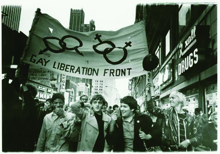 Gay Liberation Front marches on Times Square, New York City. Diana Davies, 1969. Manuscripts and Archives Division, The New York Public Library. Exhibition going on during Rare Book Week.