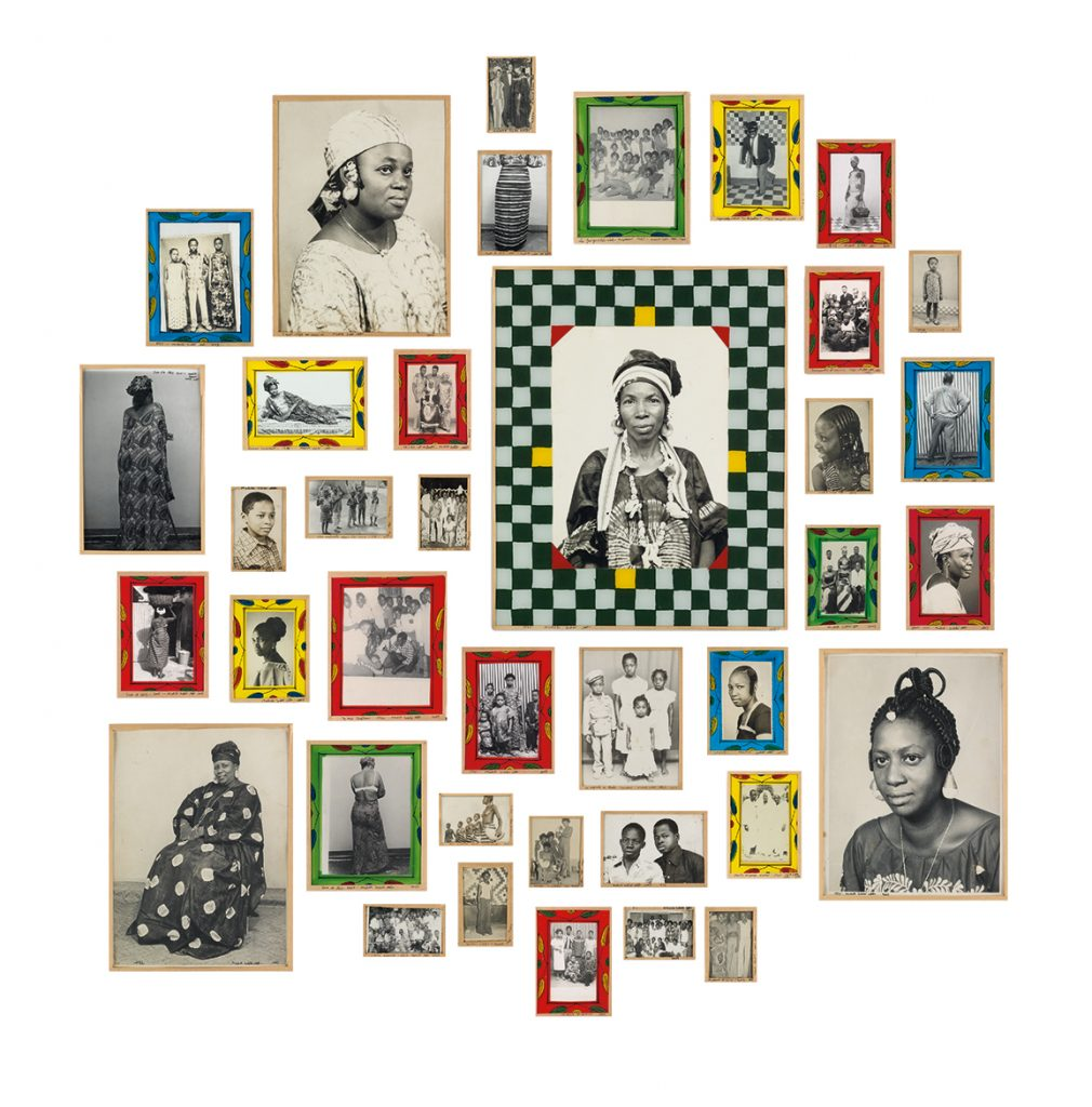 A group of photographs from Malick Sidibé in custom frames.
