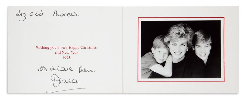 A Christmas card from Princess Diana featuring a photograph of the royal family which includes a young William and Harry.
