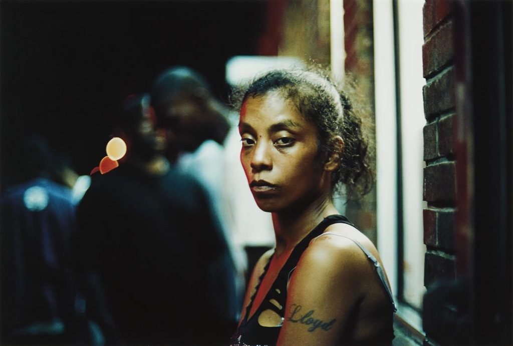 Image of a black woman looking directly at the camera by Khalik Allah.