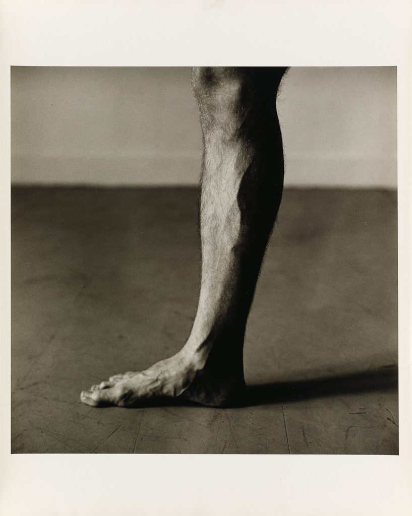 Black and white image of a leg by Peter Hujar.