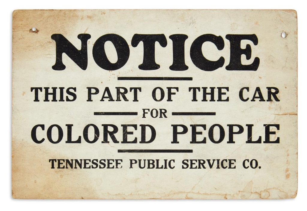 "Tennessee Jim Crow era bus sign reading ""Notice: This Part of the Car for Colored People"""