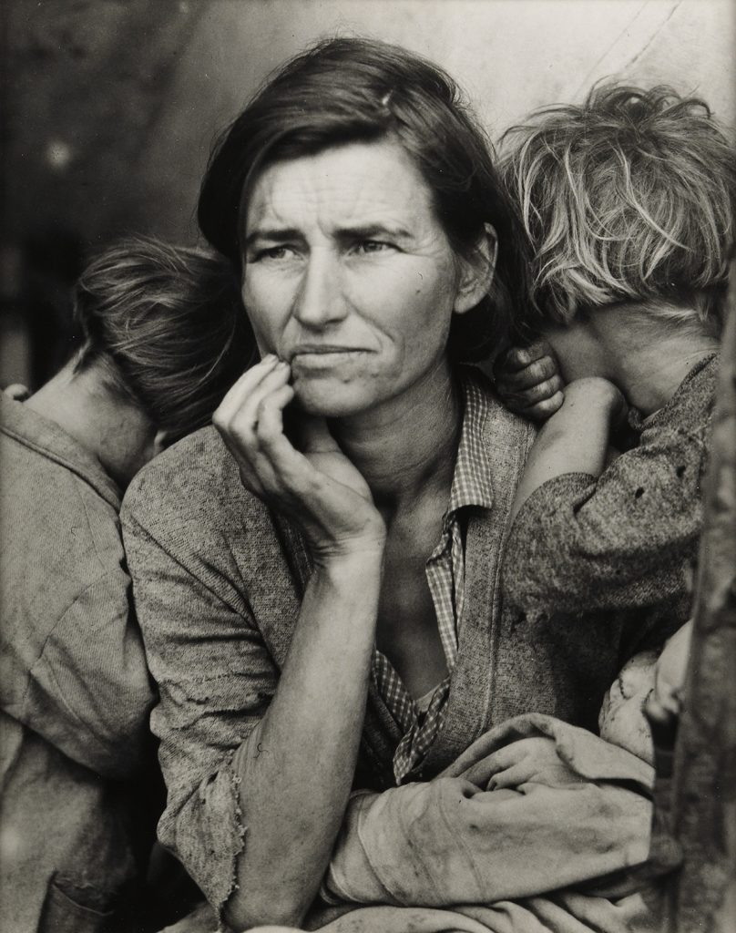 Black and white photographic portrait of a migrant mother by Dorothea Lange.