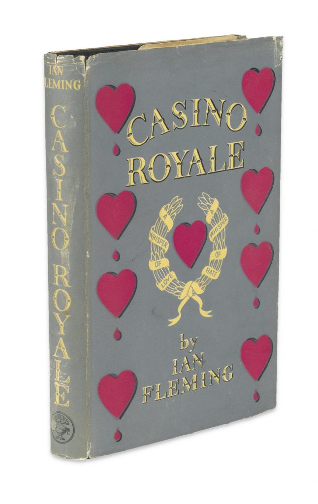 Cover image of Ian Fleming's first James Bond novel, Casino Royale. In dust jacket with a gray background with red hearts down the left and right sides.