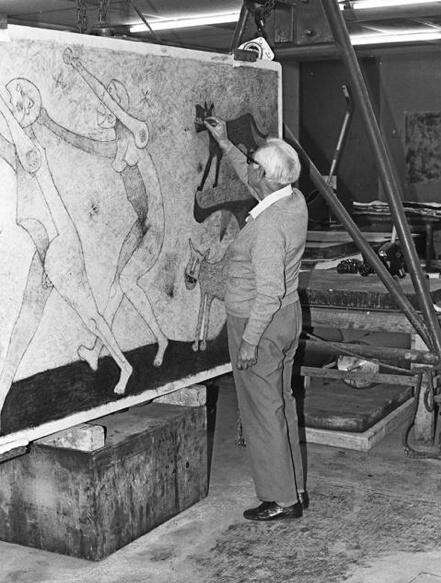 "Black and white image of Rufino Tamayo drawing on the lithograph stone for ""Dos Personajes atacados por Perros."""