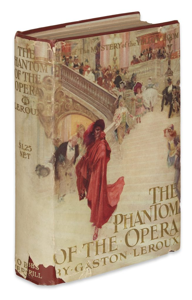 "Cover of Gaston Leroux's ""The Phantom of the Opera,"" with a scene of the Phantom walking down the steps."