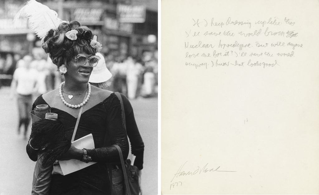 Photograph of Marsha P. Johnson at a NYC Pride parade shown with the annotation on the back of the picture by Allan Ginsberg.