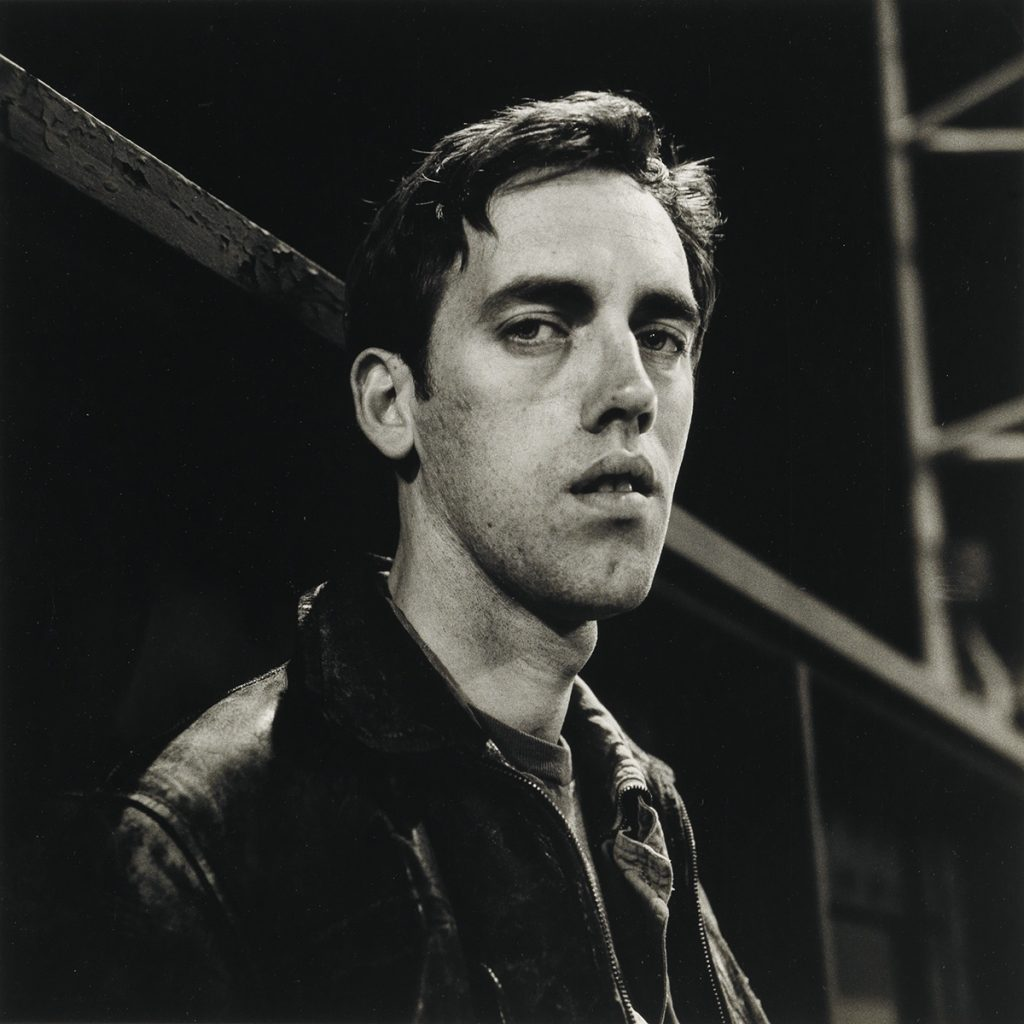 Black and white portrait photograph of David Wojnarowicz by Peter Hujar.