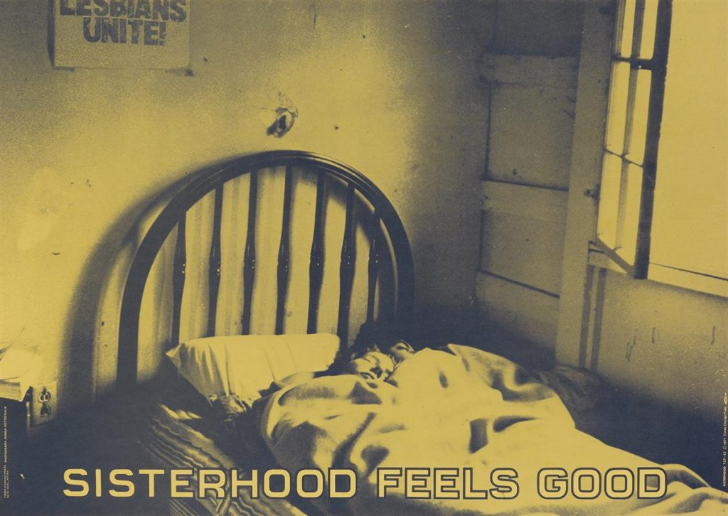 "Green tinted poster of a photograph of two women sleeping in bed with the words ""Sisterhood Feels Good"" along the bottom. By Donna Gottschalk."