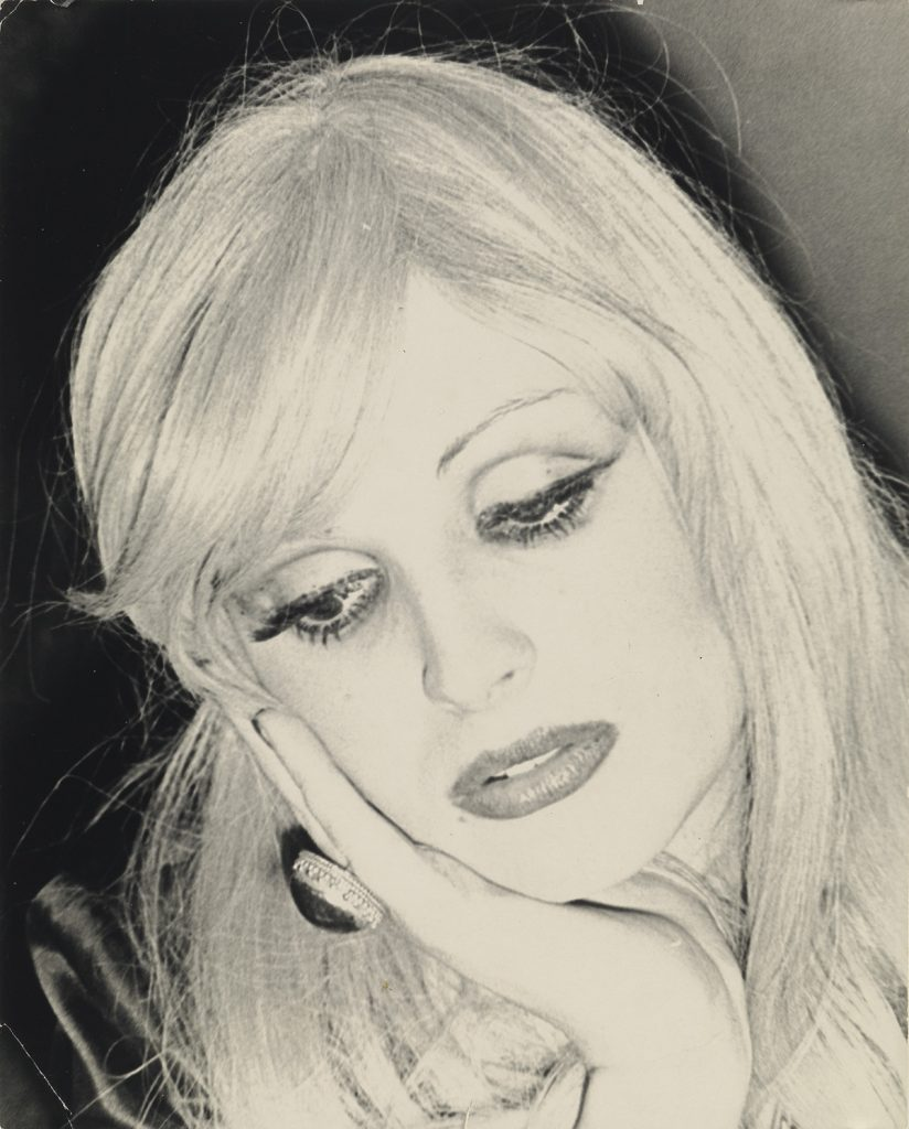 Black and white portrait photograph of Candy Darling.