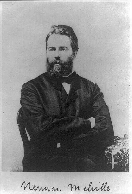 Black and white photograph of a seated Herman Melville, the author of Moby Dick, with his signature across the bottom.