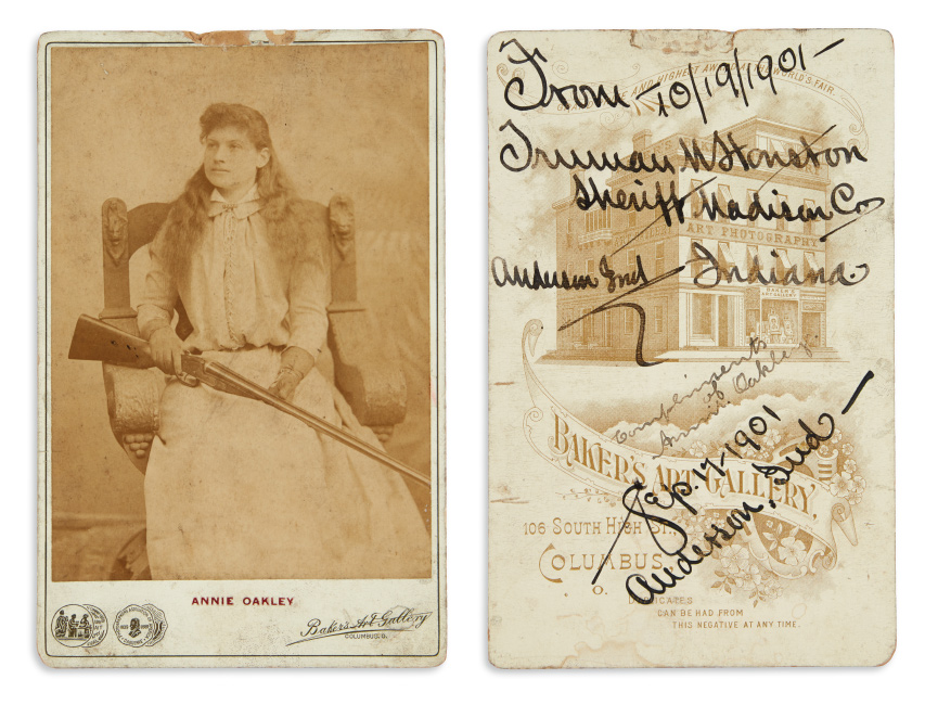 annie oakley portrait holding a gun with signature and inscription
