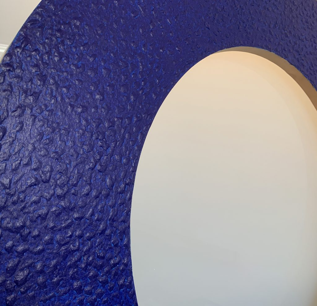 McArthur Binion, Macon: Blue, close up shot showing the detail of marking crayon on a round circle on birch plywood, 2003.