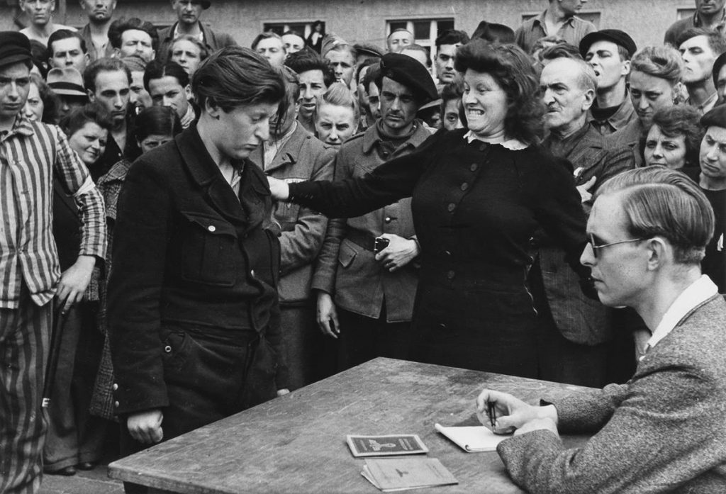Henri Cartier-Bresson, Gestapo informer recognized by a woman she had denounced, Dessau, Germany, ferrotyped silver print, 1945.