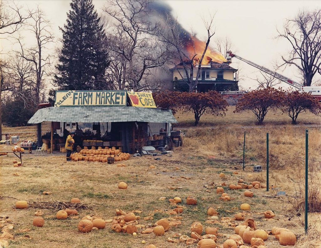 Joel Sternfield, McLean, Virginia, December 4, 1978, dye-transfer print, of a pumpkin field with a house on fire in the background, 1978.