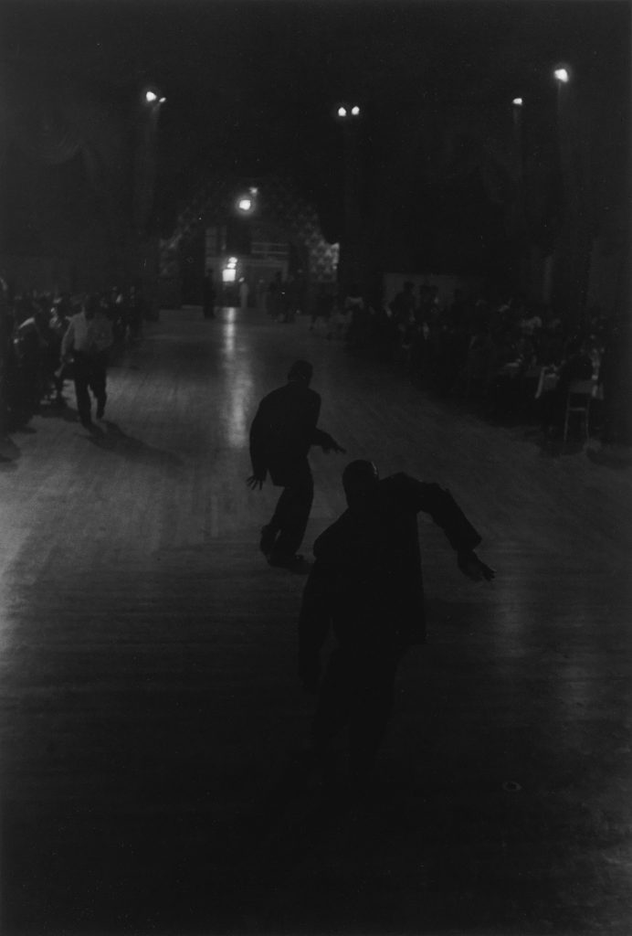 Roy DeCarava, Dancers (Harlem), black and white silver print of two shadowed figures dancing, 1955.