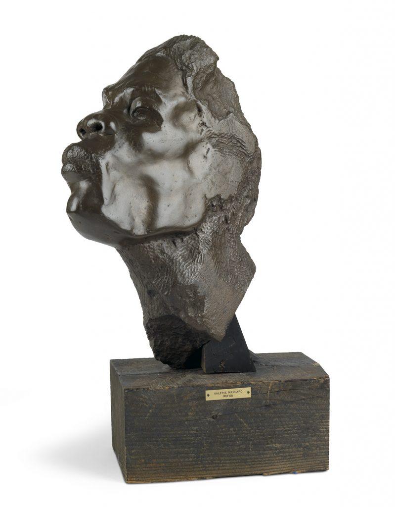 "Valerie J. Maynard, Rufus, cast ""Montizini"" plastic, mounted on wood base, sculpture of a male head, circa 1961."