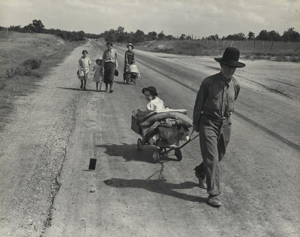 Dorothea Lange, Family walking on highway, five children, silver print, 1938, printed circa 1960.